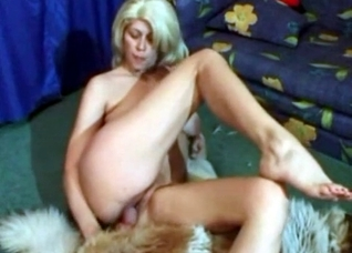 Blond-haired bombshell seducing a dog