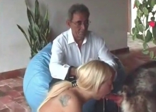 Grandpa watches this blonde fuck a dog